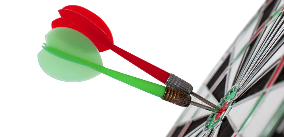 Two darts in the center of a dartboard
