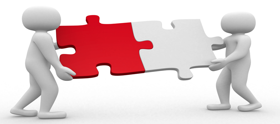 Two figures holding larger puzzle pieces that interlock